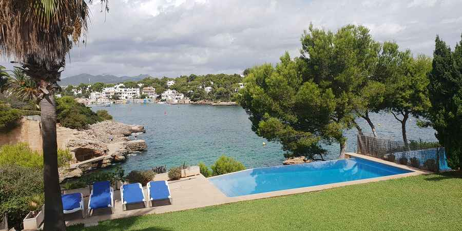 Sea front villa in Es Forti with views all the way to Cala Dor marina and beach access.